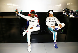 April 7, 2017 - Shanghai, China - Britain's LEWIS HAMILTON (Mercedes) takes a selfie photo with Finnish team mate VALTTERI BOTTAS (Mercedes) during practice before the FIA Formula One World Championship 2017 Grand Prix of China. (Credit Image: © Hoch Zwei via ZUMA Wire)