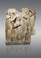 Roman Sebasteion relief sculpture of  Herakles is preparing to wrestle the Libyan giant Antaios. Aphrodisias Museum, Aphrodisias, Turkey.<br /> <br /> Herakles (left) is taking off his bow case to hang it on a pillar statue. Antaios (right) is binding up his head with ear protectors, next to him stands an oil basin used in the palaistra (wrestling ground). Antaios was a famous wrestler who challenged and killed all visitors to his country, until he was defeated by Herakles. .<br /> <br /> If you prefer to buy from our ALAMY STOCK LIBRARY page at https://www.alamy.com/portfolio/paul-williams-funkystock/greco-roman-sculptures.html . Type -    Aphrodisias     - into LOWER SEARCH WITHIN GALLERY box - Refine search by adding a subject, place, background colour, museum etc.<br /> <br /> Visit our ROMAN WORLD PHOTO COLLECTIONS for more photos to download or buy as wall art prints https://funkystock.photoshelter.com/gallery-collection/The-Romans-Art-Artefacts-Antiquities-Historic-Sites-Pictures-Images/C0000r2uLJJo9_s0
