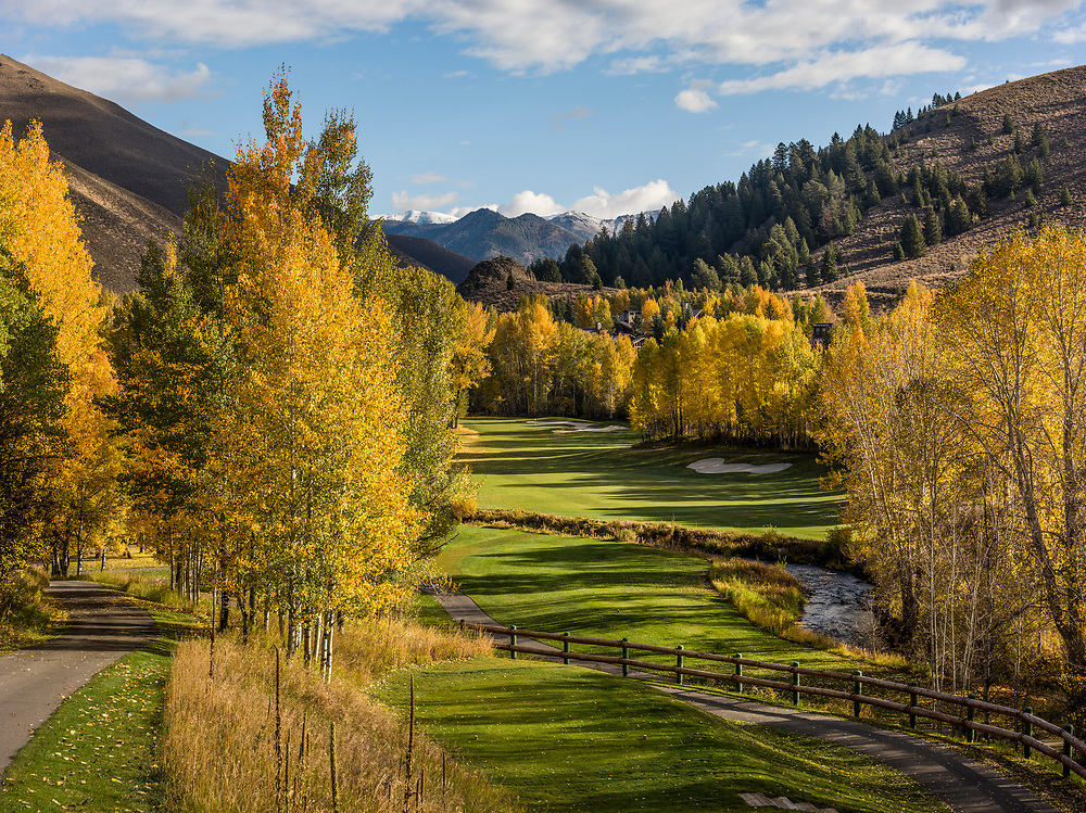 Sun Valley Resort Golf Course Trail Creek Hole #7 on a moody Autumn Day with fall colors abounding and snow dusted Trail Creek Mountains in the background. Licensing and Open Edition Prints.