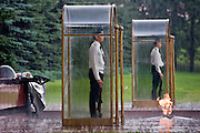 Moscow, Russia, 14/07/2006..The Kremlin Guard at the Tomb of the Unknown Soldier in Alexandrovskii Gardens during a sudden summer thunderstorm.