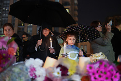 Val Mauro and her daughter Madison Zuccato, 9, hold candles at a vigil on Yonge Street in Toronto, Tuesday, April 24, 2018. Ten people were killed and 14 were injured in Monday's deadly attack in which a van struck pedestrians in northern Toronto, ON, Canada. Photo by Galit Rodan/CP/ABACAPRESS.COM