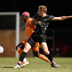 BRISBANE, AUSTRALIA - NOVEMBER 3: Abraham Yango of Eastern Suburbs and Ewan Macleod of the Knights compete for the ball during the NPL Queensland Senior Mens Round 9 match between Eastern Suburbs FC and Gold Coast Knights at Heath Park on November 3, 2020 in Brisbane, Australia. (Photo by Patrick Kearney)