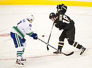 Reilly Smith of the Dallas Stars fights for the puck against Christopher Tanev (8) of the Vancouver Canucks Thursday, February 21, 2013 at the American Airlines Center in Dallas, Texas. (Cooper Neill/The Dallas Morning News)