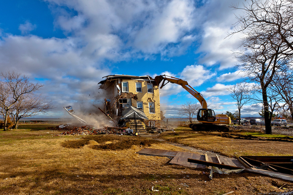 Union Beach's Iconic Princess Cottage home takes a blow from a demolition effort by non-profit Burners Without Boarders who are providing free demolition services to areas of North Jersey.