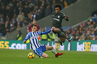 Football - 2017 / 2018 Premier League - Brighton and Hove Albion vs. Chelsea<br /> <br /> Willian of Chelsea skips over the tackle of Solly March of Brighton at The Amex Stadium Brighton <br /> <br /> COLORSPORT/SHAUN BOGGUST