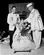 Y-540612-069 Rosarian placing crown on Queen Jan I. On the left is the President of the Portland Rose Festival. June 12, 1954.