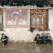 POrtrait of the 5th King and his family. Lunch break during a snow storm. Visiting the only school in Laya village.