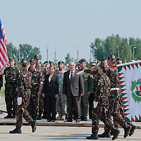 Eleni Tsakopoulos Kounalakis ambassador for the United States of America and Csaba Hende Defence Minister for Hungary inspect the honour guards before the presentation of the Coalition Support Fund for Hungary by the US military in Szolnok, Hungary on July 18, 2011. ATTILA VOLGYI