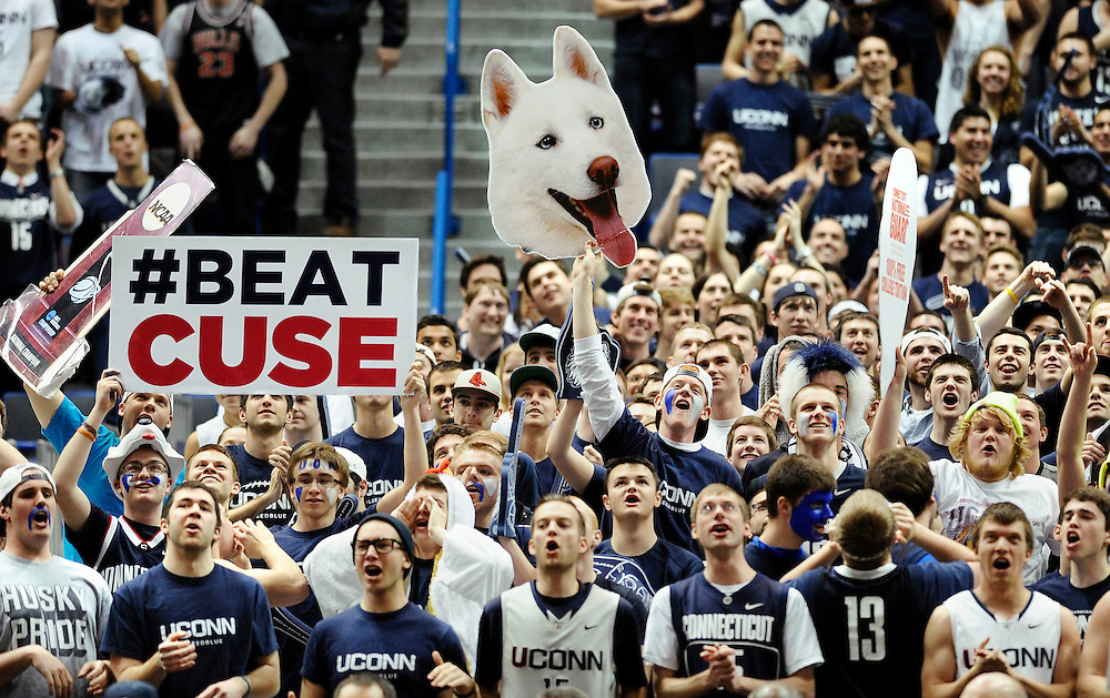 Connecticut fans cheer during the first half of an NCAA college basketball game against Syracuse in Hartford, Conn., Wednesday, Feb. 13, 2013. (AP Photo/Jessica Hill)
