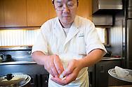 Sushi chef Masatoshi Yoshino is making nigiri sushi at his restaurant Yoshino Sushi Honten, Tokyo, Japan