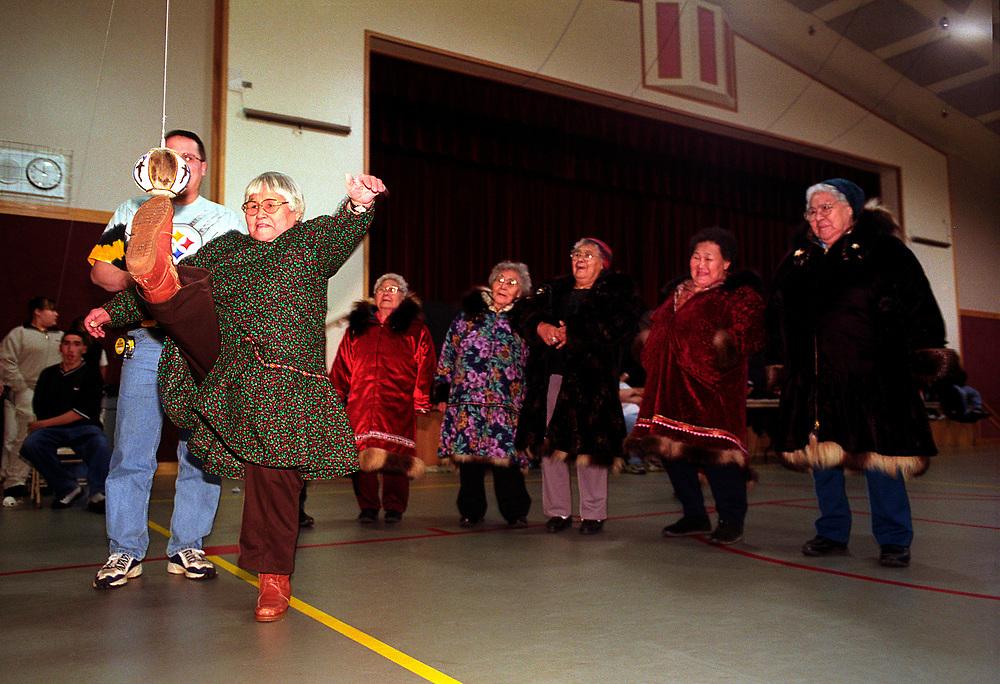 Alaska, Barrow. Elder ladies one foot high kick competition. Christmas games.