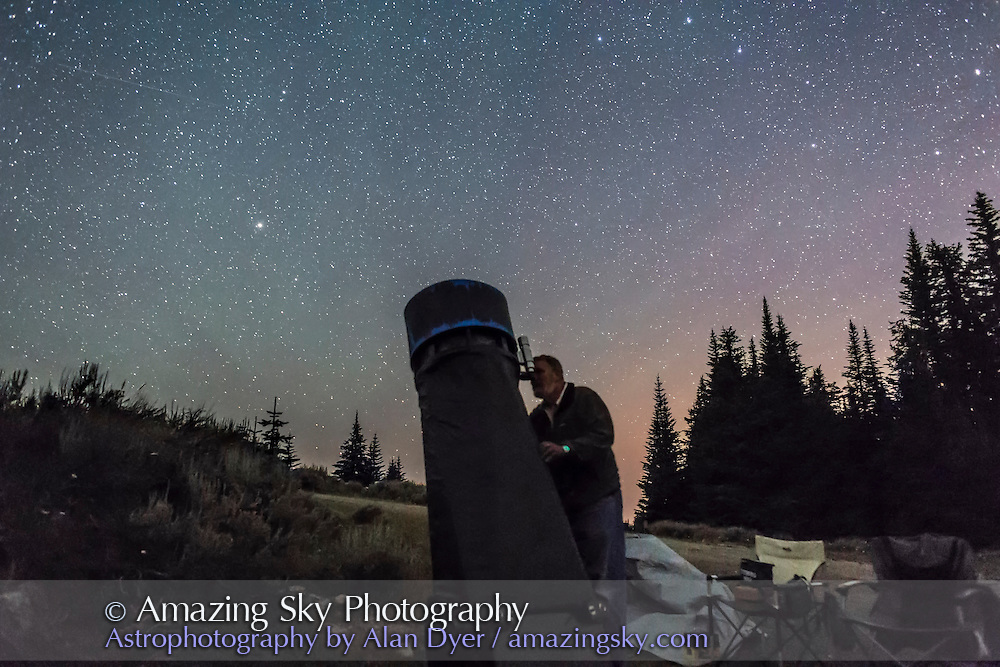 Lee Johnson at the eyepiece of a Dobsonian telescope at 2014 Mt. Kobau Star Party, under a sky lit by some airglow. The Big Dipper is at upper right, Arcturus at left. I should have framed the sky a little better!