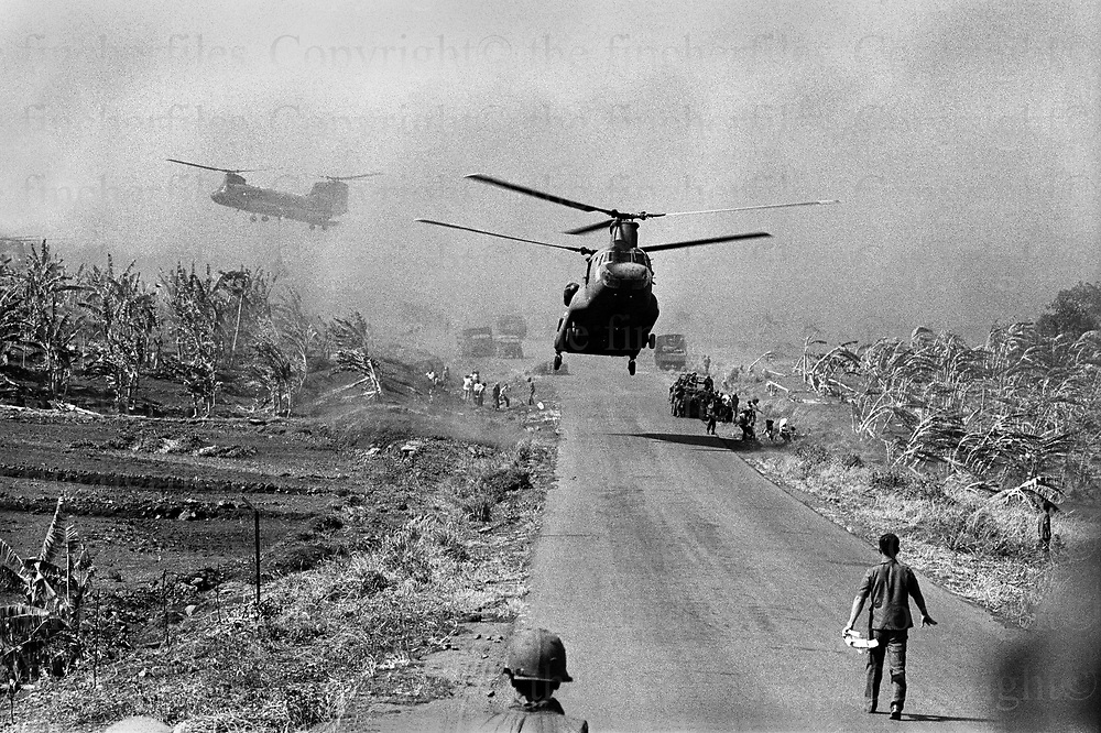 South Vietnamese army Boeing CH-47 Chinook helicopters fly in supplies near Xuan Loc in South Vietnam as the North Vietnamese  army (Viet Cong) made their advance on the city. Xuan Loc was the last major battle of the Vietnam War fought between 9th and 21st April 1975. Photographed by  Terry Fincher.