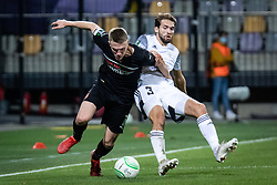 Adrien Truffert of Rennes and Klemen Pucko of NS Mura during football match between NS Mura and Rennes (FRA) in group stage of UEFA Europa Conference League 2021/22, on 20 of October, 2021 in Ljudski Vrt, Maribor, Slovenia. Photo by Blaž Weindorfer / Sportida