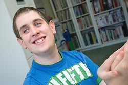 Teenage boy with Autism smiling,