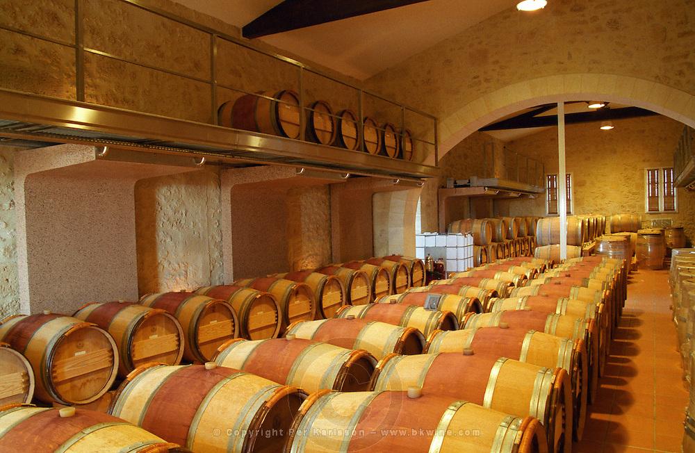 Oak barrel aging and fermentation cellar. Chateau Sansonnet, Saint Emilion, Bordeaux, France