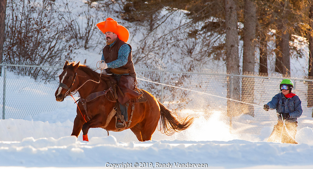 Photo Randy Vanderveen<br /> 2019-03-08<br /> Grande Prairie, Alberta<br /> Jason Beattie pulls Duane Stevenson at the Thunder in the Pines at Evergreen Park Friday evening. The inaugural skijoring event, which saw someone on skis or a snowboard pulled around by a horse or horse and rider on a closed course proved a popular event at the Foster's Peace Country Ag Classic for both spectators and participants.