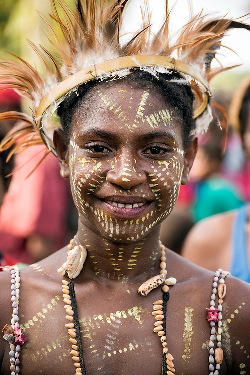A young woman in Yar village in the East Sepik Province of Papua New Guinea. The community was celebrating the dedication of the New Testament in the Waran language, one of the hundreds of languages in the country.<br /> <br /> (June 21, 2019)