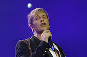 """Westlife Farewell Tour 2012 at the SECC.27-05-12...Kian Egan of Irish Super Group Westlife perform during their sell out show at the SECC in the Scottish Leg of their Farewell World Tour. ..Westlife are an Irish boy band formed in 1998. They are to disband in 2012 after their farewell tour. The group's line-up was Shane Filan, Mark Feehily, Kian Egan, and Nicky Byrne. Brian McFadden was part of the group until 2004. Westlife have sold over 45 million records worldwide which includes studio albums, singles, video release, and compilation albums.. Despite the group's worldwide success, they only have one hit single in the United States, """"Swear It Again"""", which peaked in 2000 on the Billboard Hot 100 at number 20. The band were originally signed by Simon Cowell and are managed by Louis Walsh. The group have accumulated 14 number-one singles in the United Kingdom, the third-highest in UK history, tying with Cliff Richard..The group had also broken a few records, including """"Music artist with most consecutive number 1's in the UK"""", which consists of their first seven singles and only behind The Beatles and Elvis Presley..The band have 14 UK number ones and 25 top ten singles, consisting of 20.2 million records and videos in the UK across their 14-year career - 6.8 million singles, 11.9 million albums and 1.5 million videos. The Band are best known for amazing songs such as Flying Without Wings and Safe....At The SECC, Glasgow..Picture  Mark Davison/ ProLens PhotoAgency/ PLPA.Sunday 27th May 2012."""
