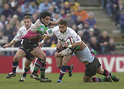 Photo - Peter Spurrier<br /> 08/02/2003 <br /> RUGBY - NEC Harlequins v Sale Sharks<br /> Jason Robinson on the attaack tackled by Andre Vos right and Tani Fuga