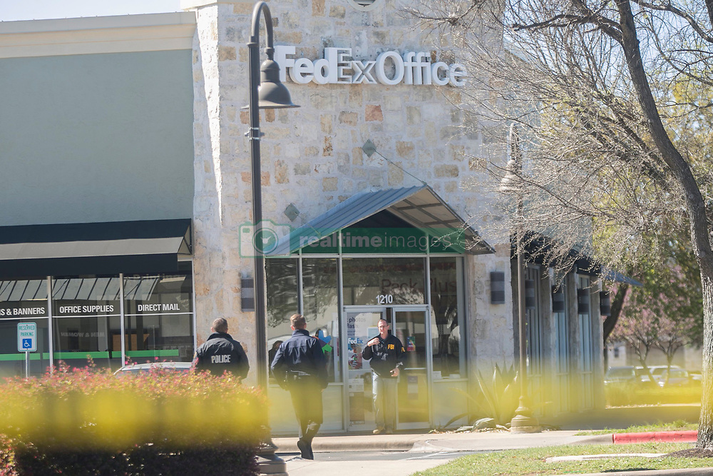 On March 20, 2018, investigators, including FBI officers, roped off a FedEX Office store located in the Southwest Austin suburb of Sunset Valley. Sunset Valley police think that a package that exploded early Tuesday at a FedEx sorting facility in Schertz may have been shipped from this FedEx Office location. Photo by Reshma Kirpalani/Austin American-Statesman/TNS/ABACAPRESS.COM