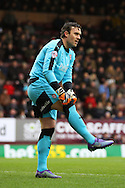 Rotherham United Goalkeeper Lee Camp pulls his socks up. Skybet football league Championship match, Burnley v Rotherham United at Turf Moor in Burnley, Lancs on Saturday 20th February 2016.<br /> pic by Chris Stading, Andrew Orchard sports photography.