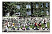 Krakau, Poland, Jul 15, 2005, Children coming from school PHOTO©Christophe VANDER EECKEN