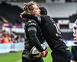 Ospreys' Jeff Hassler celebrates scoring his sides first try with team-mate Sam Davies<br /> <br /> Photographer Craig Thomas/Replay Images<br /> <br /> Guinness PRO14 Round 13 - Ospreys v Cardiff Blues - Saturday 6th January 2018 - Liberty Stadium - Swansea<br /> <br /> World Copyright © Replay Images . All rights reserved. info@replayimages.co.uk - http://replayimages.co.uk