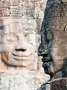 Stones faces built into the walls of the Bayon temple at Angkor, Siem Reap Province, Cambodia