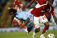 Photo: Rich Eaton.<br /> <br /> Bristol City v Manchester City. Carling Cup. 29/08/2007. Man City's Emile Mpenza (l) falls under the challenge of Marvin Elliott.