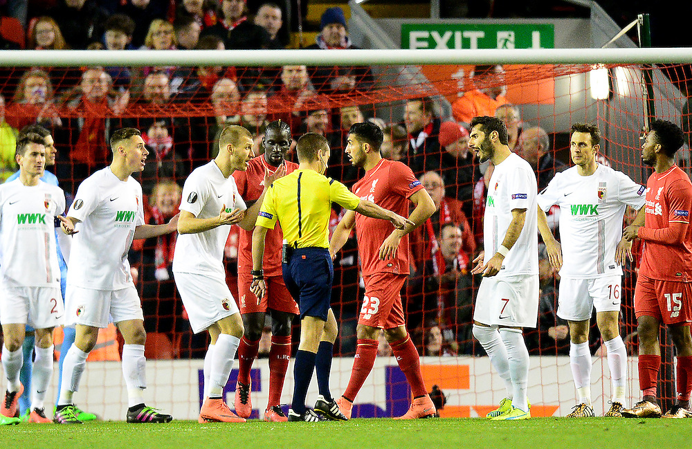 Referee Clement Turpin awards Liverpool a penalty as the Augsburg players protest<br /> <br /> Photographer Richard Martin-Roberts/CameraSport<br /> <br /> Football - UEFA Europa League Round of 32 - Liverpool v Augsburg - Thursday 25th February 2016 - Anfield - Liverpool<br /> <br /> © CameraSport - 43 Linden Ave. Countesthorpe. Leicester. England. LE8 5PG - Tel: +44 (0) 116 277 4147 - admin@camerasport.com - www.camerasport.com