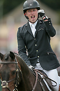 Simon Grieve punches the air having gone around the show jumping ring with a clear round on Drumbilla Metro in the CCI*** event on the final day of the Bramham International Horse Trials 2017 at Bramham Park, Bramham, United Kingdom on 11 June 2017. Photo by Mark P Doherty.
