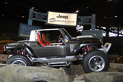 06 February 2005:  Jeep's Hurricane concept must be the most maneuverable and powerful 4x4 ever built. Equipped with two 5.7-liter Hemi V-8 engines: one in the front and one in the back, there was a total of 670 horsepower and 740 lb-ft of torque available on demand. Two modes of automated four-wheel steering were used, first, the traditional with rear tires turning in the opposite direction of the front. A second mode turned all four-wheels in the same direction for nimble crab-like steering. With 14.3 inches of ground clearance, and 37-inch tall tires, there wasn't much that the Hurricane couldn't climb. The black one-piece structural carbon fiber body also formed the chassis, plus suspension and power train were mounted directly to the body. Chrysler Group Multi-Displacement System (MDS) enabled the Hurricane to alternate between 4-, 8-, 12- or 16-cylinders and clock 0-60 mph in less than five-seconds.<br /> <br /> First staged in 1901, the Chicago Auto Show is the largest auto show in North America and has been held more times than any other auto exposition on the continent.  It has been  presented by the Chicago Automobile Trade Association (CATA) since 1935.  It is held at McCormick Place, Chicago Illinois