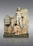 Roman Sebasteion relief  sculpture of Emperor Nero with captive, Aphrodisias Museum, Aphrodisias, Turkey. <br /> <br /> Naked warrior emperor Nero holds the orb of world rule in one hand and crowns the military trophy with the other. Between the trophy and the emperor stands a bound captive boy. He wears long barbarian trousers and looks up at Nero. .<br /> <br /> If you prefer to buy from our ALAMY STOCK LIBRARY page at https://www.alamy.com/portfolio/paul-williams-funkystock/greco-roman-sculptures.html . Type -    Aphrodisias     - into LOWER SEARCH WITHIN GALLERY box - Refine search by adding a subject, place, background colour, museum etc.<br /> <br /> Visit our ROMAN WORLD PHOTO COLLECTIONS for more photos to download or buy as wall art prints https://funkystock.photoshelter.com/gallery-collection/The-Romans-Art-Artefacts-Antiquities-Historic-Sites-Pictures-Images/C0000r2uLJJo9_s0