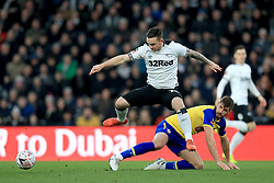 Derby County's Jack Marriott (left) and Southampton's Jack Stephens battle for the ball during the Emirates FA Cup, third round match at Pride Park, Derby.