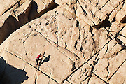 A rock climber free climbs The Dome in Boulder Canyon, near Boulder, Colorado.