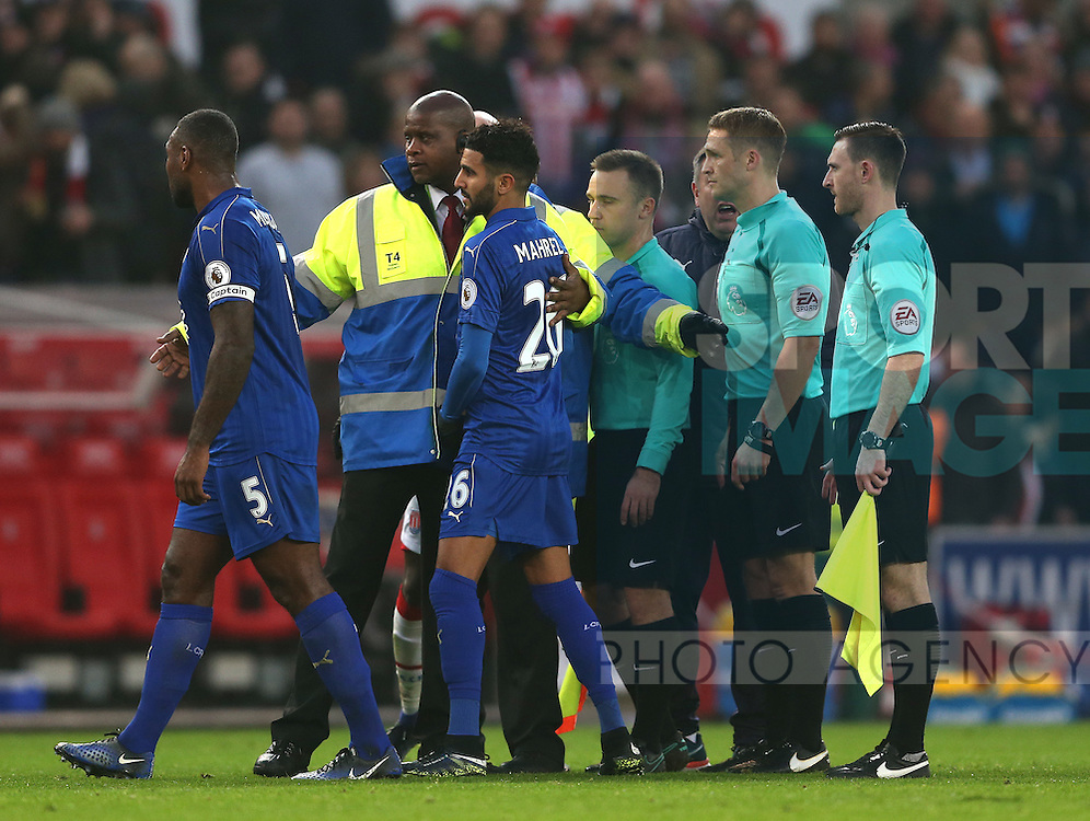 Wes Morgan and Riyad Mahrez of Leicester City are led away from referee Craig Pawson at half time during the English Premier League match at the Bet 365 Stadium, Stoke on Trent. Picture date: December 17th, 2016. Pic Simon Bellis/Sportimage