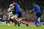 Paul O'Connell of Ireland is tackled around his neck by Yoann Maestri of France (5). Rugby World Cup 2015 pool D match, France v Ireland at the Millennium Stadium in Cardiff, South Wales  on Sunday 11th October 2015.<br /> pic by  Andrew Orchard, Andrew Orchard sports photography.