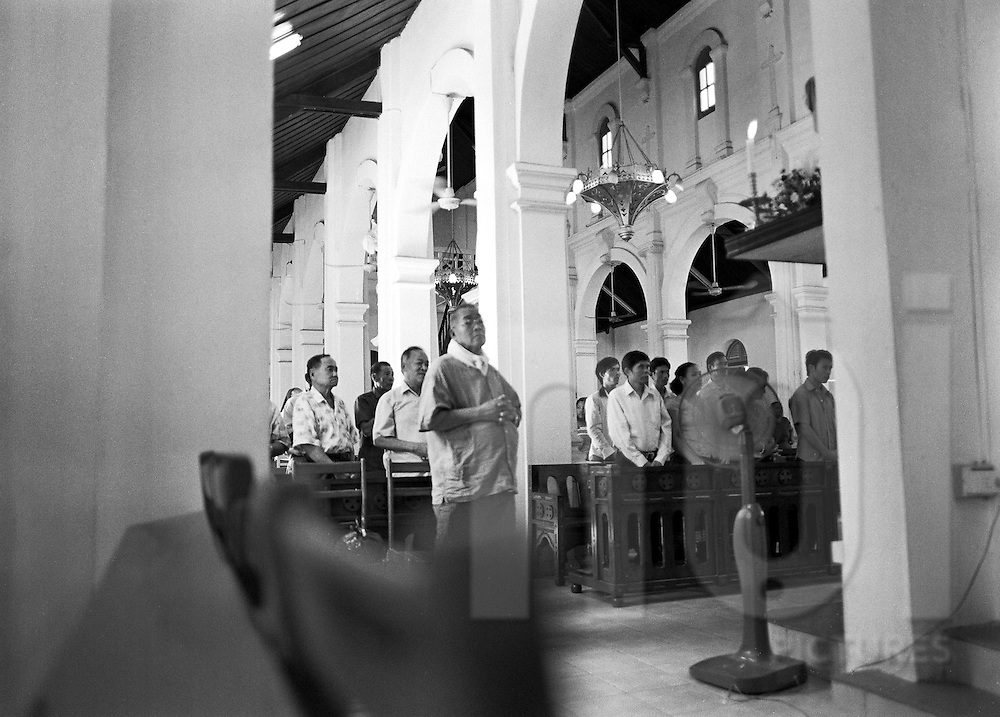 Group or worshipers listening at the priest during the mass in a church of Vientiane, Laos, Asia