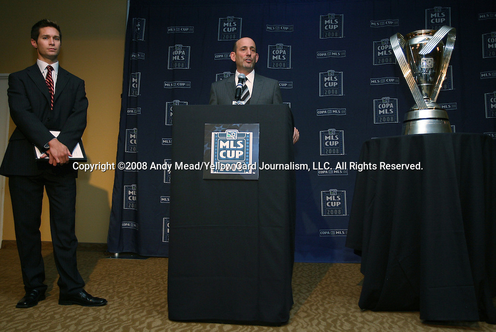 21 November 2008: Major League Soccer commissioner Don Garber (center) with the new Philip F. Anschutz Trophy and director of communications Dan Courtemanche (left).The Commissioner's Press Conference for the 2008 MLS Cup was held in the Westside Room of the Hyatt Regency Center Plaza in Los Angeles, California.