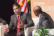 Senator and GOP presidential candidate Marco Rubio is questioned by Sen. Tim Scott during Tim's Presidential Town Hall meeting at the Performing Arts Center August 7, 2015 in North Charleston, SC. The event showcases republican candidates in a town hall style meetings hosted by Sen. Tim Scott and Rep. Trey Gowdy.