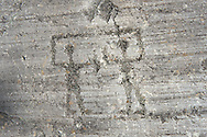 Petroglyph, rock carving, of two warriors with swords and small round shileds carved by the ancient Camuni people in the iron age between  900-1200 BC. Rock 26-27, Foppi di Nadro, Riserva Naturale Incisioni Rupestri di Ceto, Cimbergo e Paspardo, Capo di Ponti, Valcamonica (Val Camonica), Lombardy plain, Italy .<br /> <br /> Visit our PREHISTORY PHOTO COLLECTIONS for more   photos  to download or buy as prints https://funkystock.photoshelter.com/gallery-collection/Prehistoric-Neolithic-Sites-Art-Artefacts-Pictures-Photos/C0000tfxw63zrUT4<br /> If you prefer to buy from our ALAMY PHOTO LIBRARY  Collection visit : https://www.alamy.com/portfolio/paul-williams-funkystock/valcamonica-rock-art.html