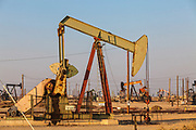 Pumpjacks at the Lost Hills Oil Field and hydraulic fracking site. Kern County, San Joaquin Valley, California, USA