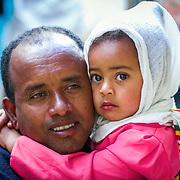 INDIVIDUAL(S) PHOTOGRAPHED: Assaye Haile Leoul (left) and Atsede Mariam Assaye (right). LOCATION: Mecha Health Center, Bahir Dar, Ethiopia. CAPTION: Child patient Atsede Mariam Assaye, and her father Assaye Haile Leoul, wait for their turn to be seen.