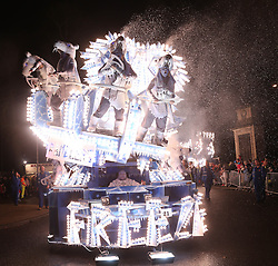 © Licensed to London News Pictures. 12/11/2014. Shepton Mallett, UK The carnival makes it way through Shepton Mallett on 12th November 2014. The carnivalis widely regarded as one of the largest illuminated processions in the world.A trail of breath taking carts parade through towns in Somerset in November as part of a tradition which dates back to the Gunpowder Plot on the Houses of Parliament in 1605.The 2 week-long spectacle can draw crowds of up to 150,000 and sees hundreds of entries from across the county.Dedicated members of the numerous carnival clubs who take part design and build carts in secrecy, some of the carts costs thousands of pounds to build , most of the money raised in charity events in a bid to win awards for the best carts. The specially-designed carts measure up to 100ft long, feature state-of-the-art electronics and hydraulics, and are decorated with thousands of light bulbs.The Last carnival this year will be at Glastonbury on Saturday night and a crowd is expected of 100 000 people to watch the three hour event. Photo credit : Jason Bryant/LNP