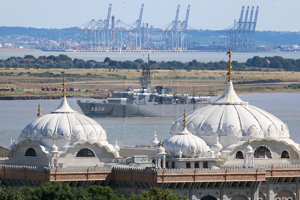 """© Licensed to London News Pictures. 31/07/2016. A 143-metre-long Japanase navy ship has sailed up the Thames and into London. The training ship passed under Tower Bridge at 1pm and moored alongside HMS Belfast. She was commissioned in 1995 and notably had a small collision with the QE2 cruise ship in 2000, after which a Japanese admiral noted it had been """"an honour to be kissed by the Queen Elizabeth."""" JDS Kashima remains in London until Wednesday afternoon. Credit: Rob Powell/LNP"""