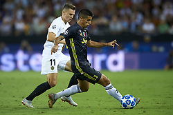 September 19, 2018 - Valencia, Spain - Joao Cancelo, Denis Cheryshev (L)competes for the ball during the Group H match of the UEFA Champions League between Valencia CF and Juventus at Mestalla Stadium on September 19, 2018 in Valencia, Spain. (Credit Image: © Jose Breton/NurPhoto/ZUMA Press)