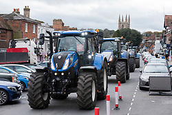 © Licensed to London News Pictures; 23/10/2020; Marlborough, UK. A Save British Farming protest with tractors through the centre of Marlborough campaigning to maintain food standards which are under threat from a post-Brexit trade deal with the USA. There's a family stand off with local MP for Devizes, Danny Kruger, who rejected the Lords' amendments to the Agriculture Bill to maintain food and environmental standards. But his mother the famous cook Prue Leith is asking to keep those standards and Save British Farming want his mother to win this argument with the aid of tractors. Photo credit: Simon Chapman/LNP.