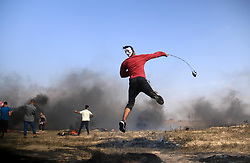 April 27, 2018 - Bureij, Gaza Strip, Palestinian Territory - Palestinian protesters clash with Israeli security forces during tents protest demanding the right to return to their homeland, at the Israel-Gaza border, in Bureij in the cetner of Gaza strip on April 27, 2018  (Credit Image: © Mahmoud Khattab/APA Images via ZUMA Wire)