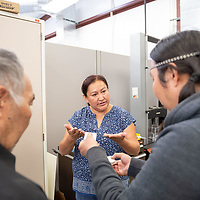 Industrial Engineer Lisa Willis, center, explains to the Yakuts delegates some of the materials students of the industrial engineering program at Navajo Technical University develop. The Yakuts delegates visited the facilities in Crownpoint on Monday.